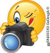 Picture of a smiley face with a camera.