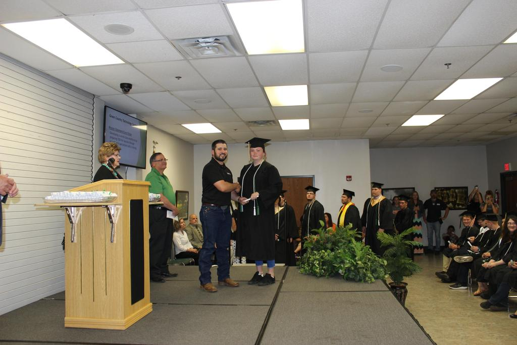 Student receives diploma