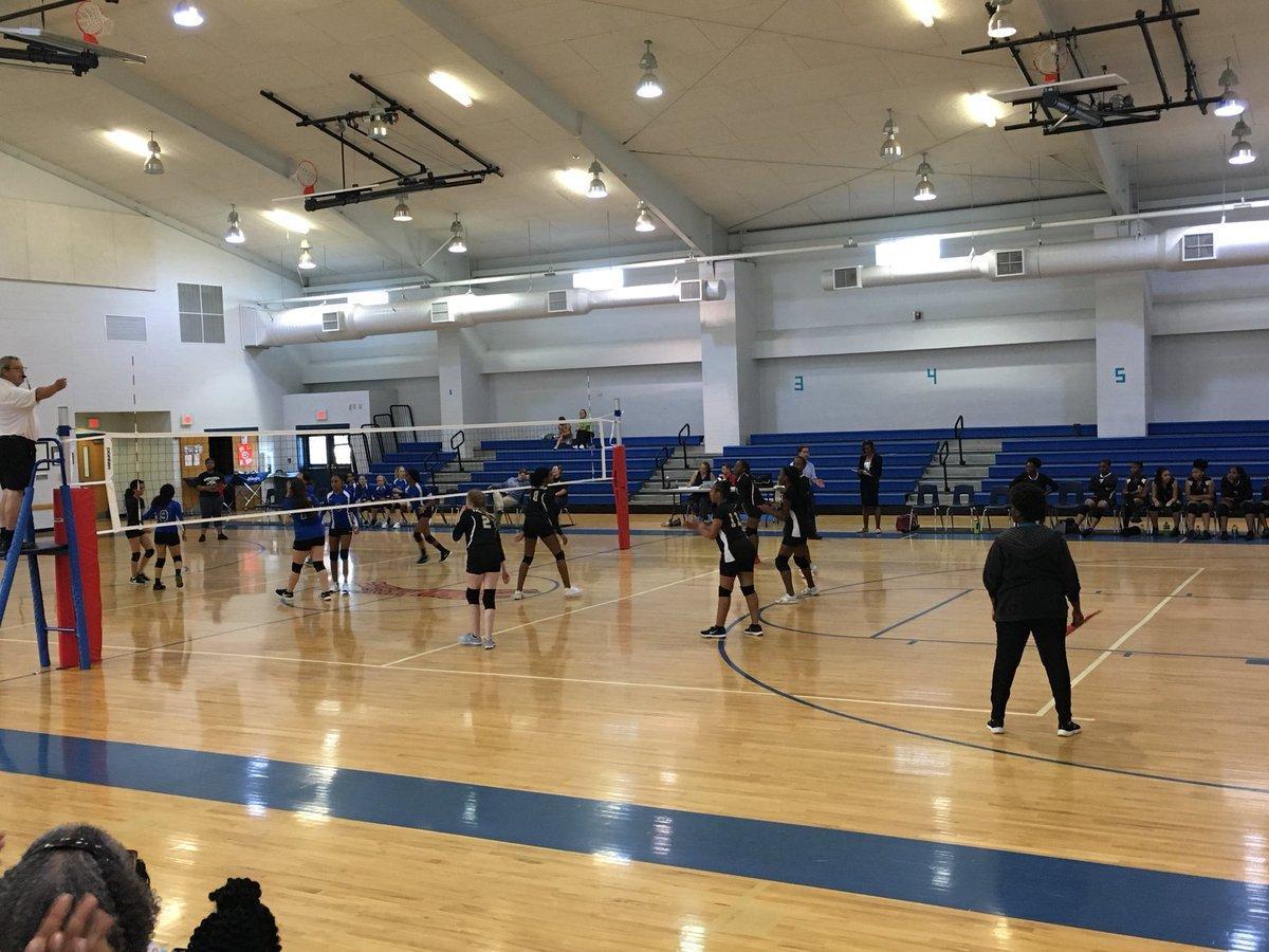 Volleyball team hitting ball