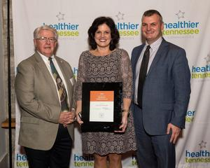 Mayor W.T. Daniels, Wellness Coordinator Tracy Green, City Administrator Todd Smith with award