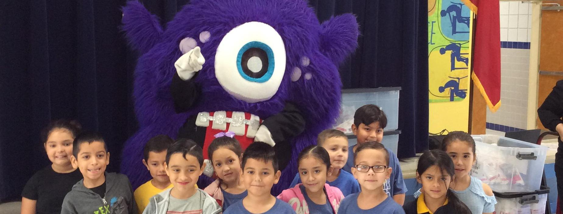 students with dental mascot