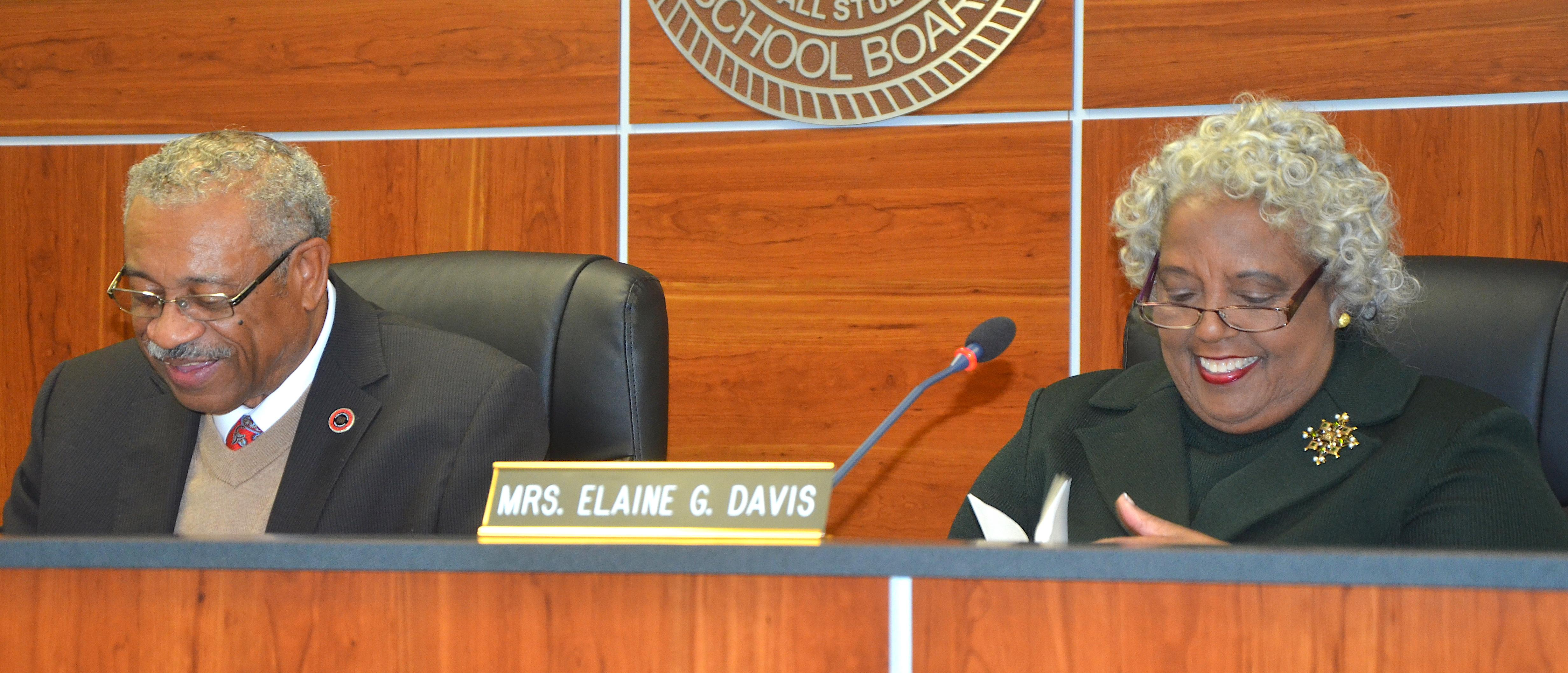 Photo of new Baker School Board Chairman, Dr. Dana Carpenter, and Elaine Davis sharing a laugh at board meeting