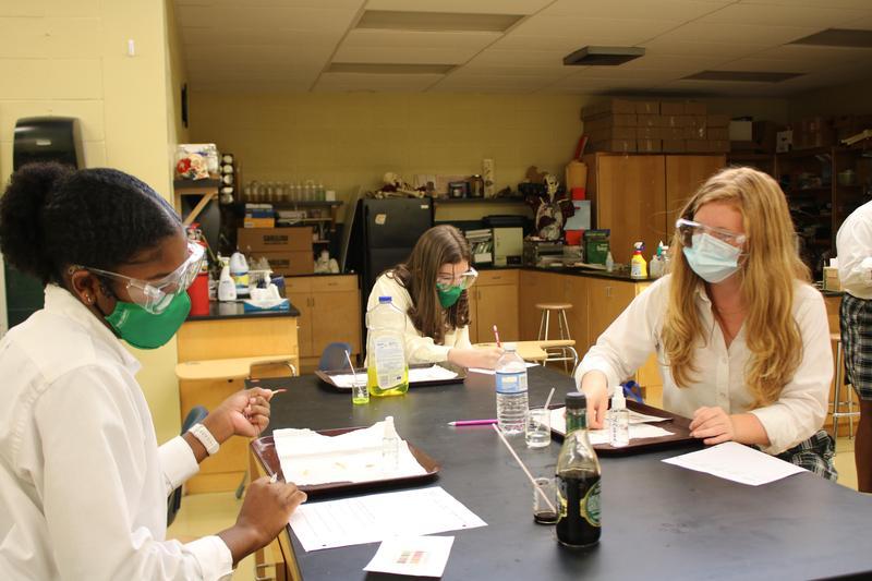three girls science lab