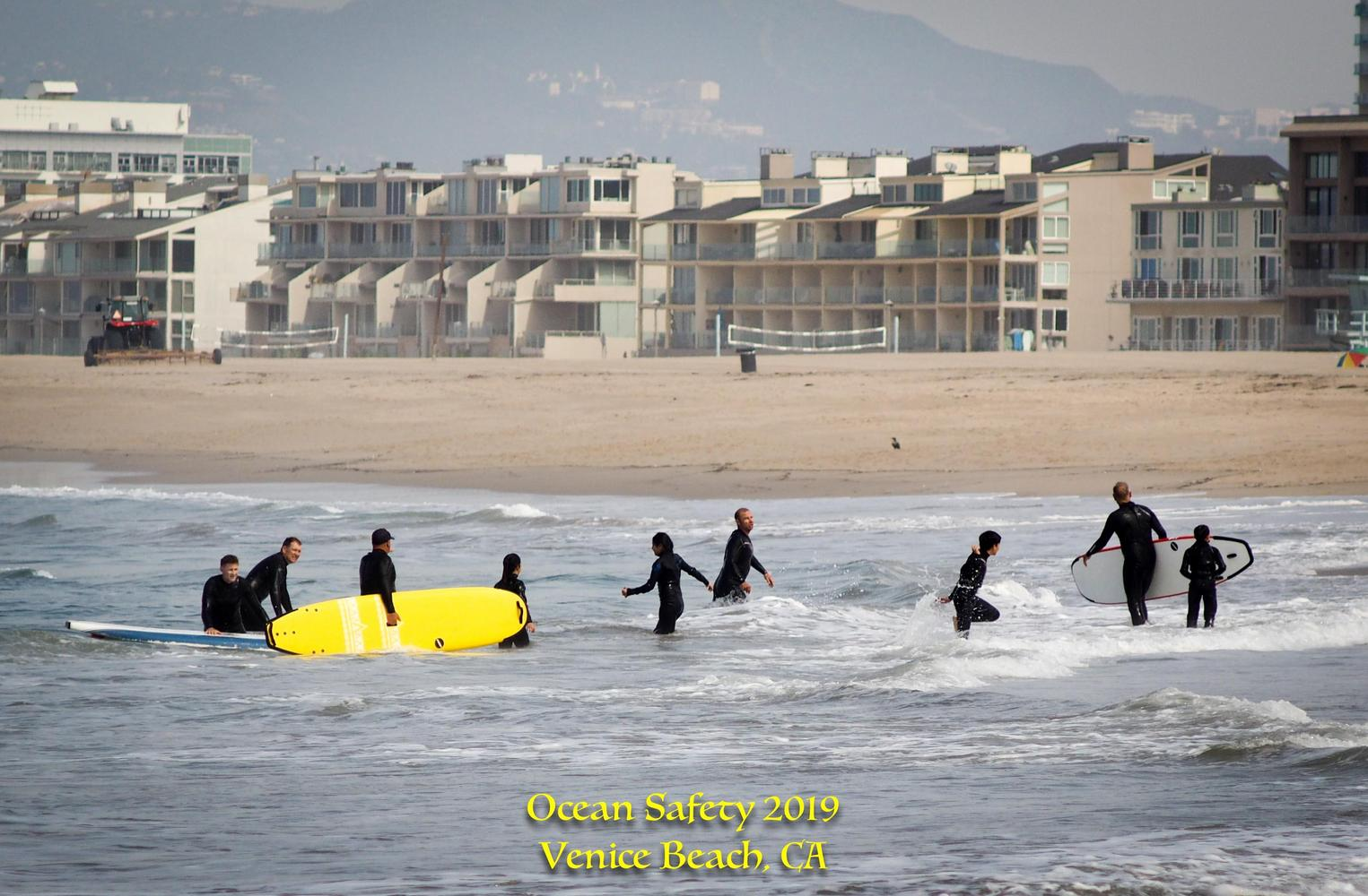 students learning how to surf at venice beach