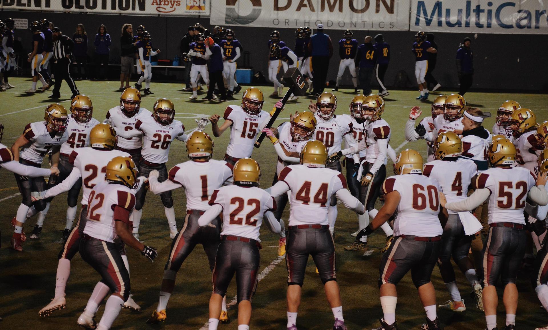 Football team surrounding the hammer