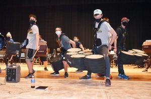 """Members of Mars Area High School's Mars Indoor Percussion team rehearse their show, """"Turn on the Light."""""""