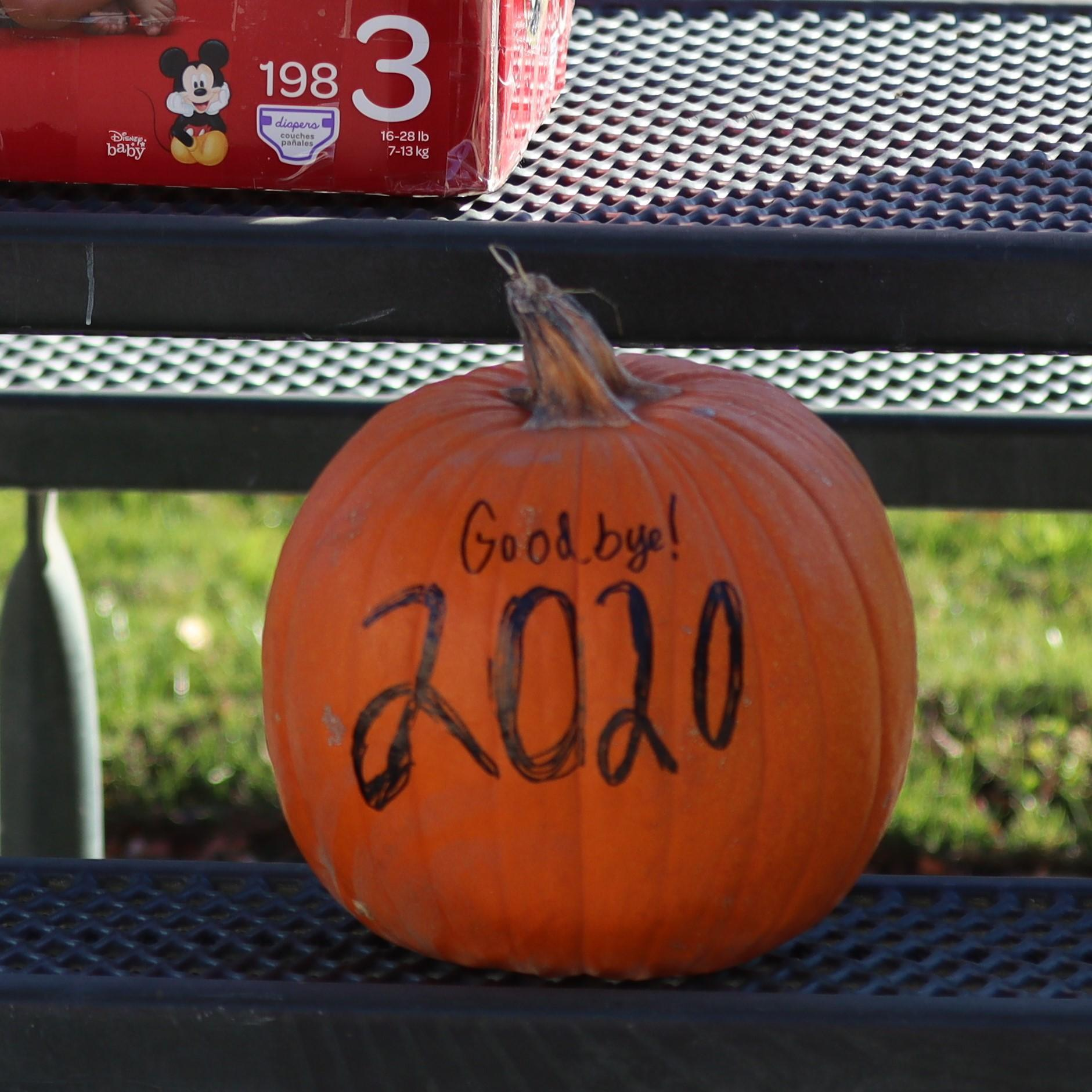 2020 pumpkin before being thrown at the ground.