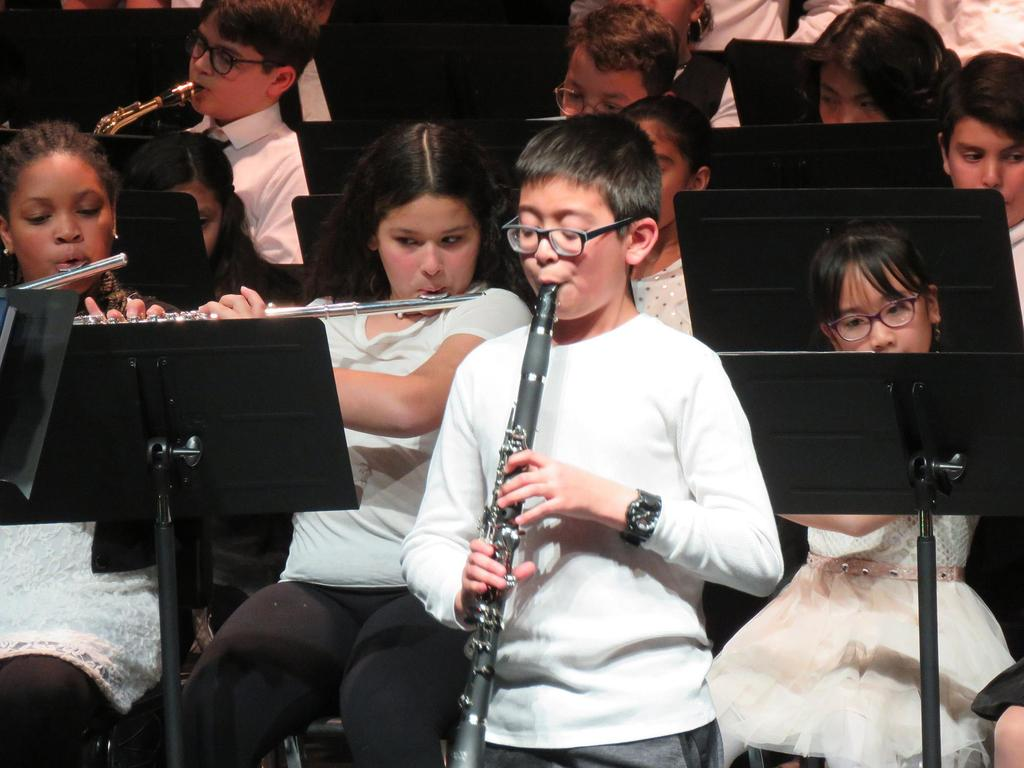 A fifth grader plays the opening notes to Jingle Bells on the clarinet