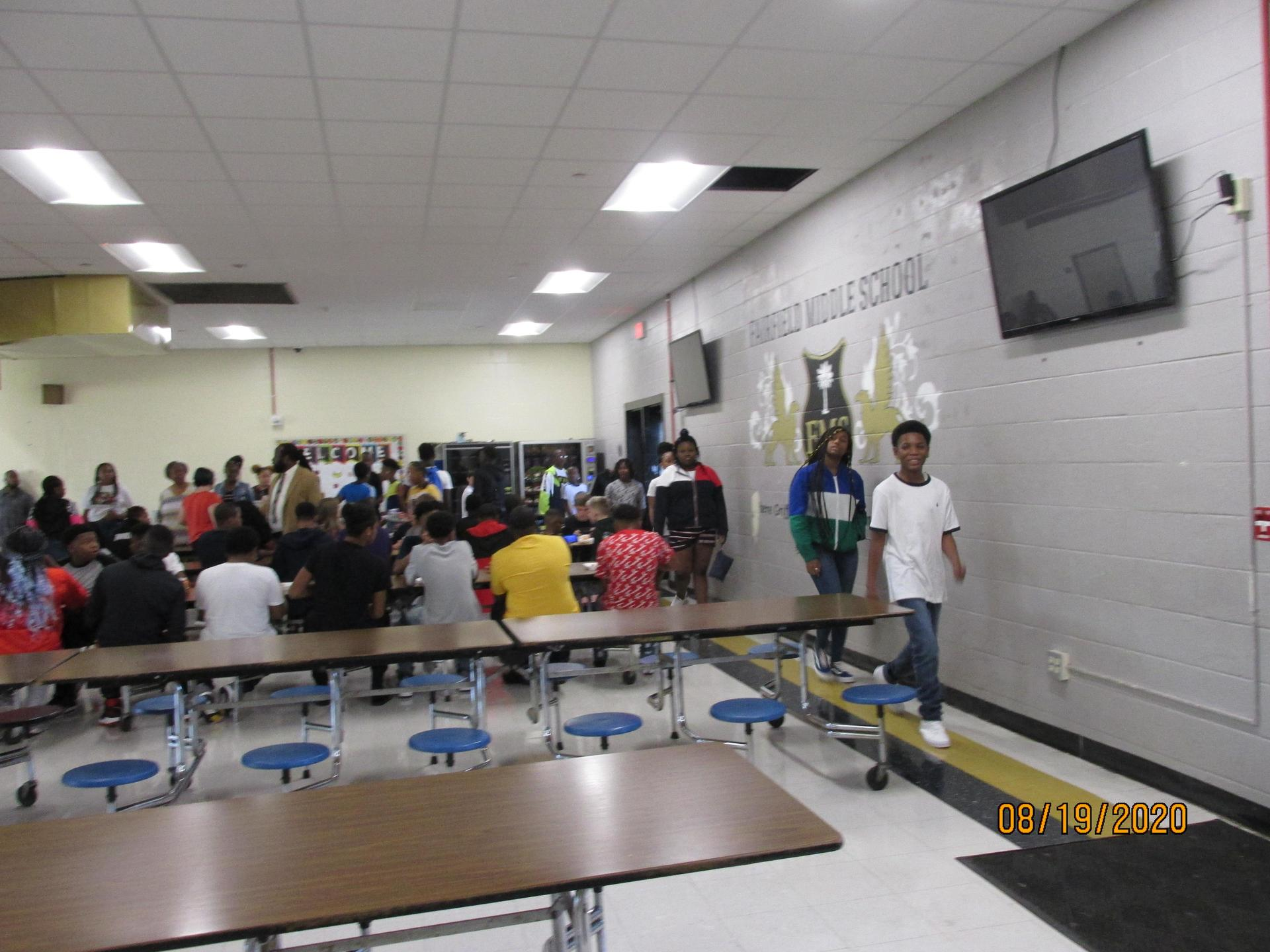 Students sitting at tables in the cafe