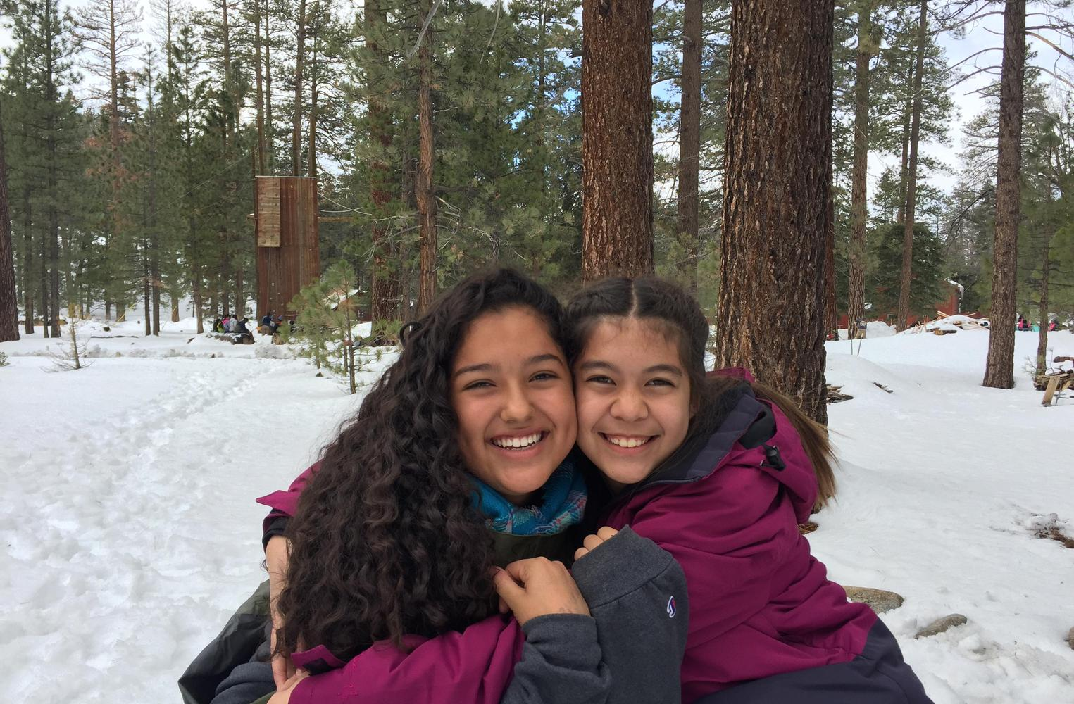 Two students enjoying the snow at science camp