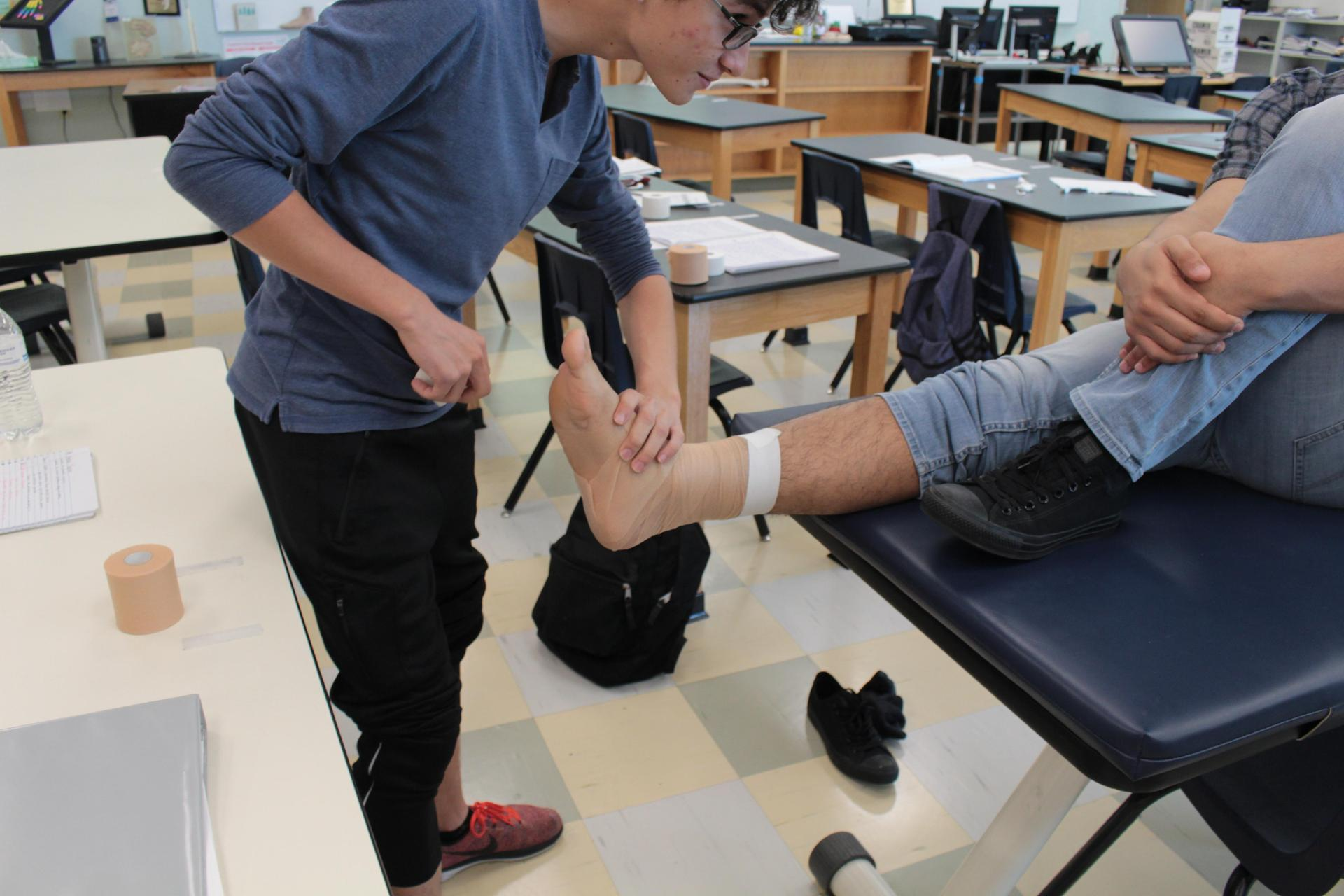 Students in Sports Medicine learning to wrap an ankle