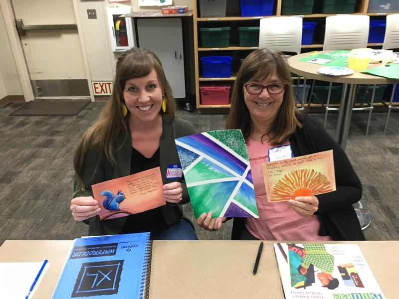 Two teachers with artwork