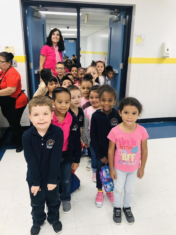 Ms. K and her kindergartner class wearing pink