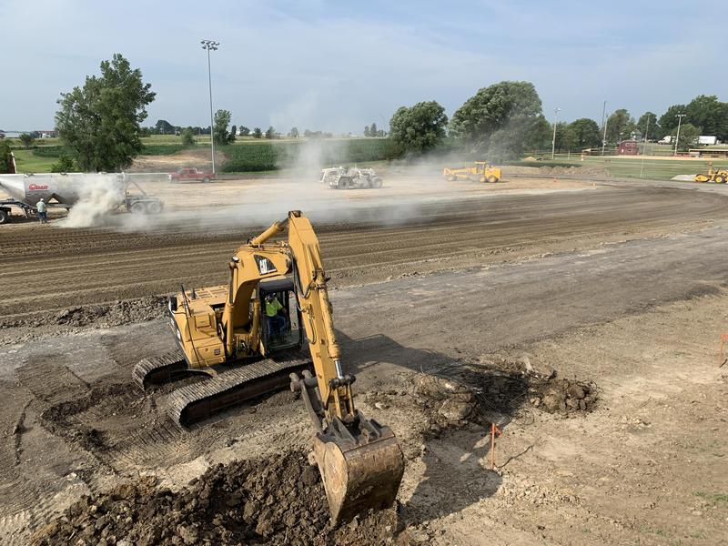 Tractor Digging in football field