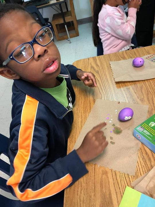 learning about how vinegar dissolves colored tablets while dying Easter eggs