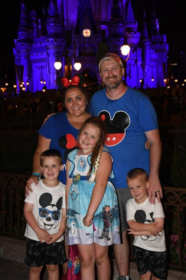 The Tunison Family in front of Magic Kingdom