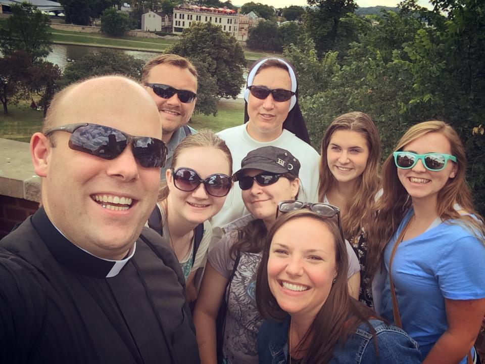 Priest and students at World Youth Day