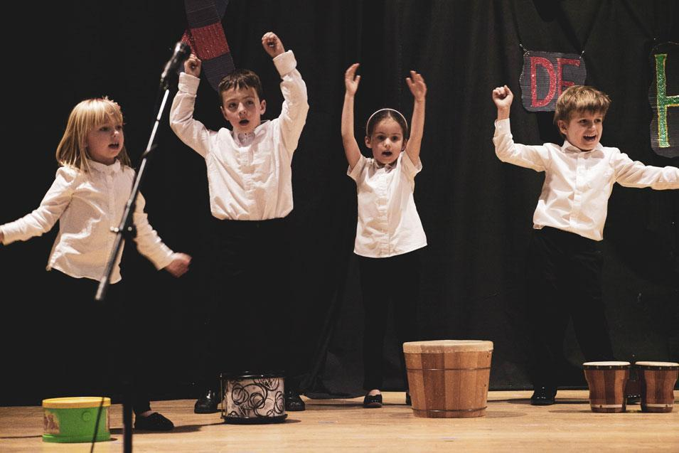 Students at HudsonWay Immersion School perform a music recital