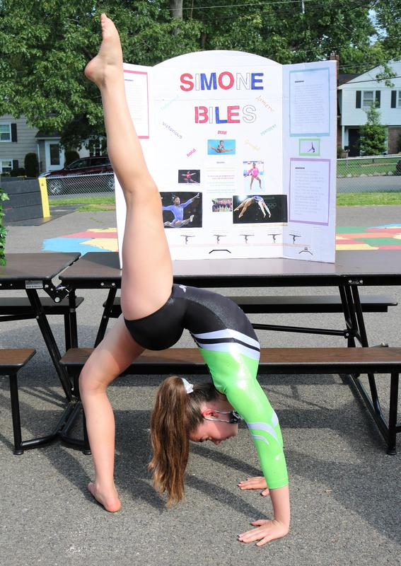 Photo of Wilson 5th grader dressed as Simone Biles and striking a gymnast pose