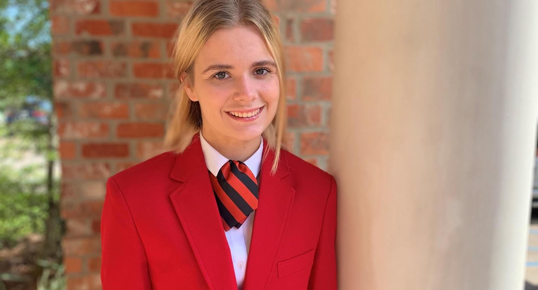 Janie Ewing-State FCCLA Vice President of Parliamentarian Law with FCCLA jacket. L