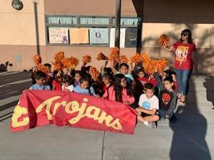 Students represent University of Southern California with their teacher