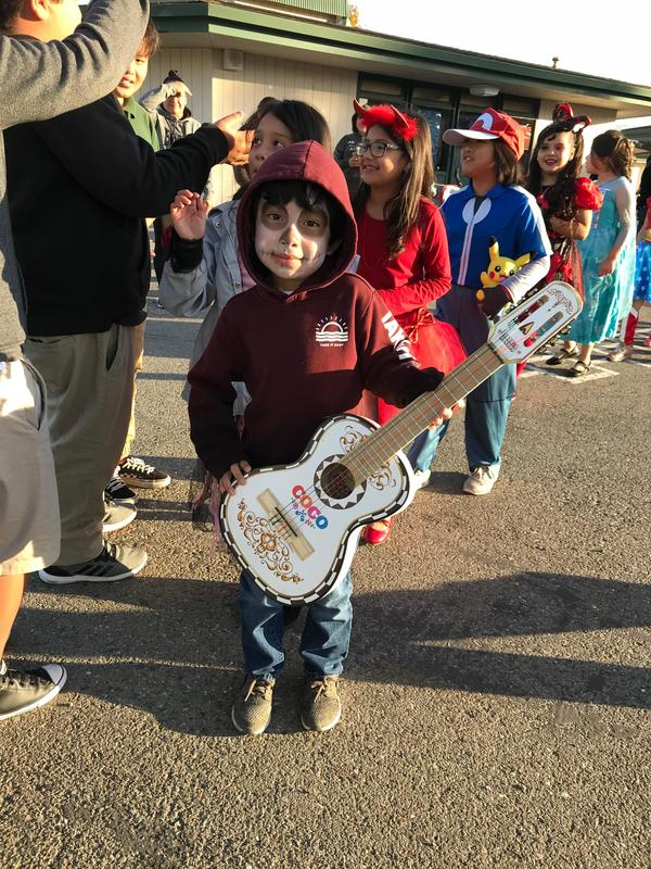 a student dressed as Miguel from Coco