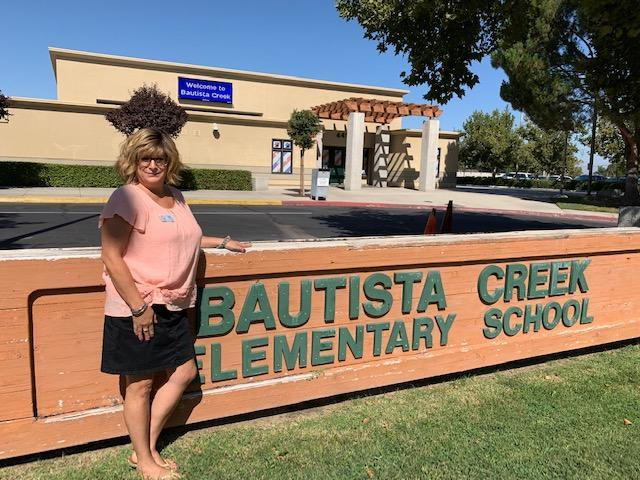 Terri Tavares in front of a Bautista Creek sign.