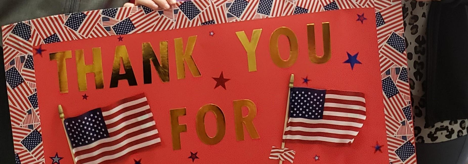 Poster with American flag border that reads Thank You for your service