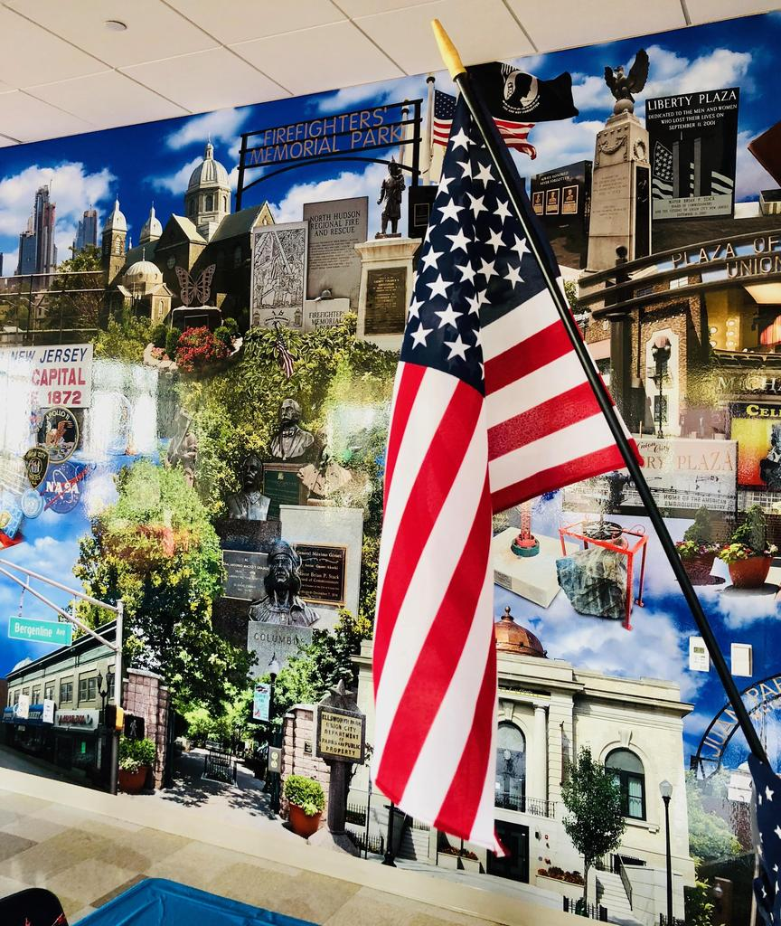 union City memorial mural with the american flag in front