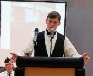 TKHS student Christopher VanDyke reads a poem during the assembly.