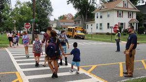 McKinley School principal Marc Biunno and crossing guard greet students and families as they arrive during first week of school.