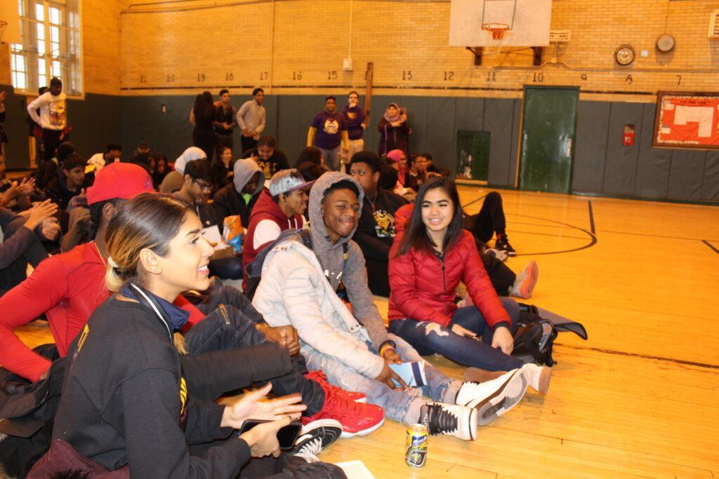 students sitting in gym