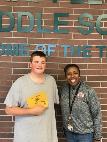 Andrew Swift receives his Student of the Month certificate from Principal Kelli Arnold-Wegner.