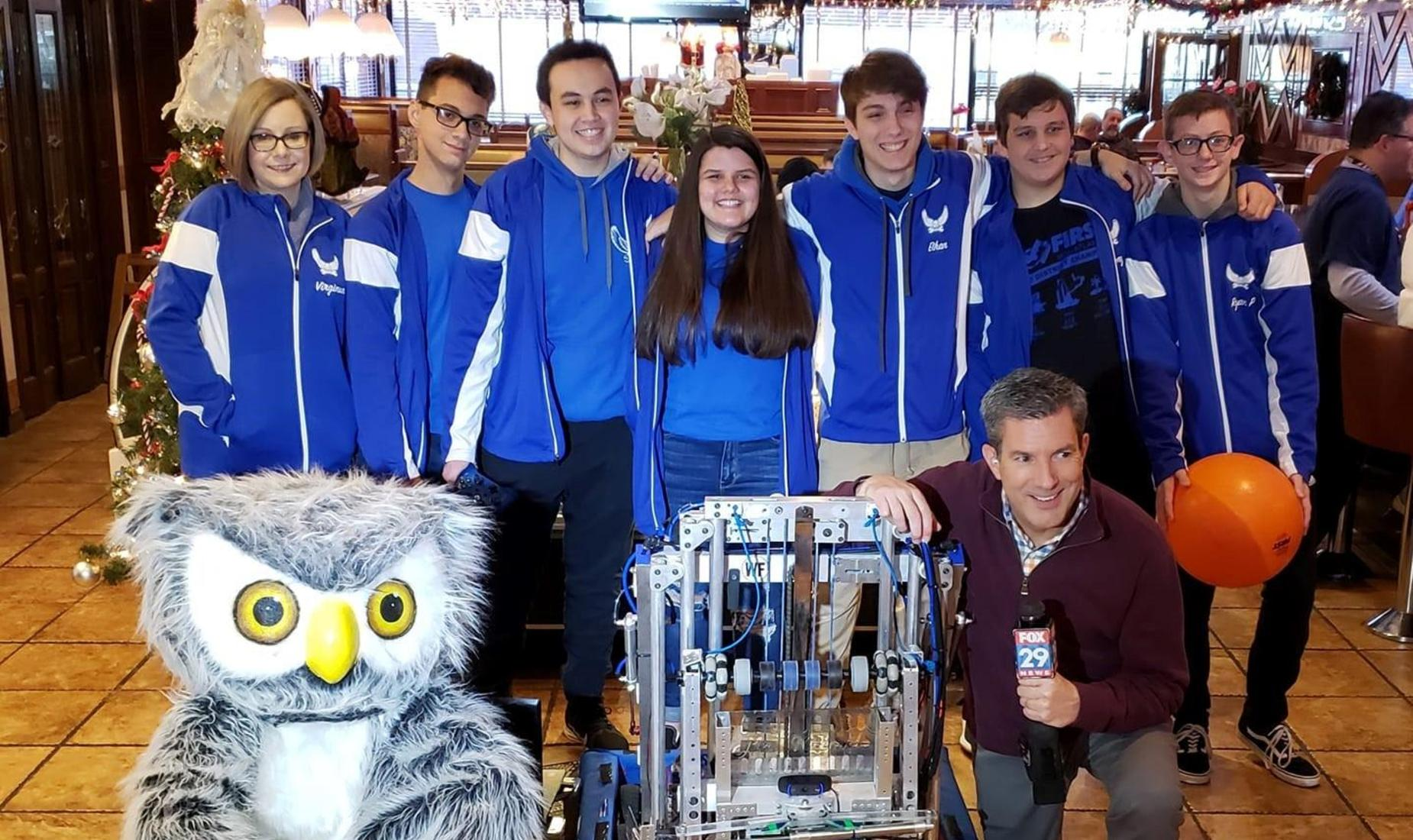 6 Members of the BHS Fightin' Robotic Owls Team and their Coach with mascot Benny the Owl and Bob Kelly from Fox 29