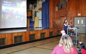 Photo of children book author Wendy Mass speaking to students on Read Across America Day.