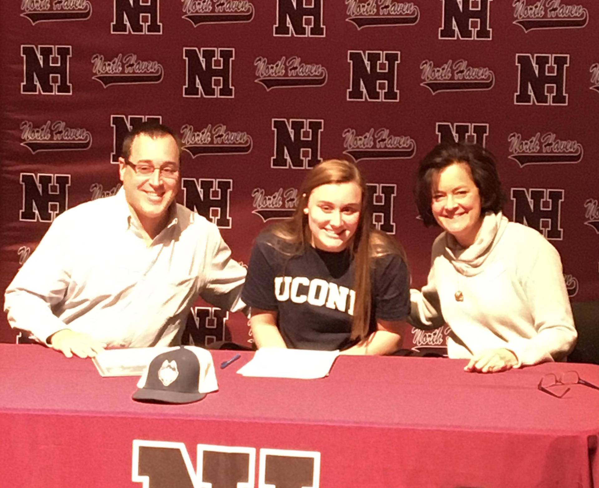 Angela Gambardella with her parents after signing her NLI.