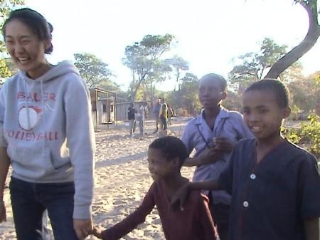 Student in Africa with children