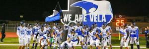 SaberCat football players running out of tunnel