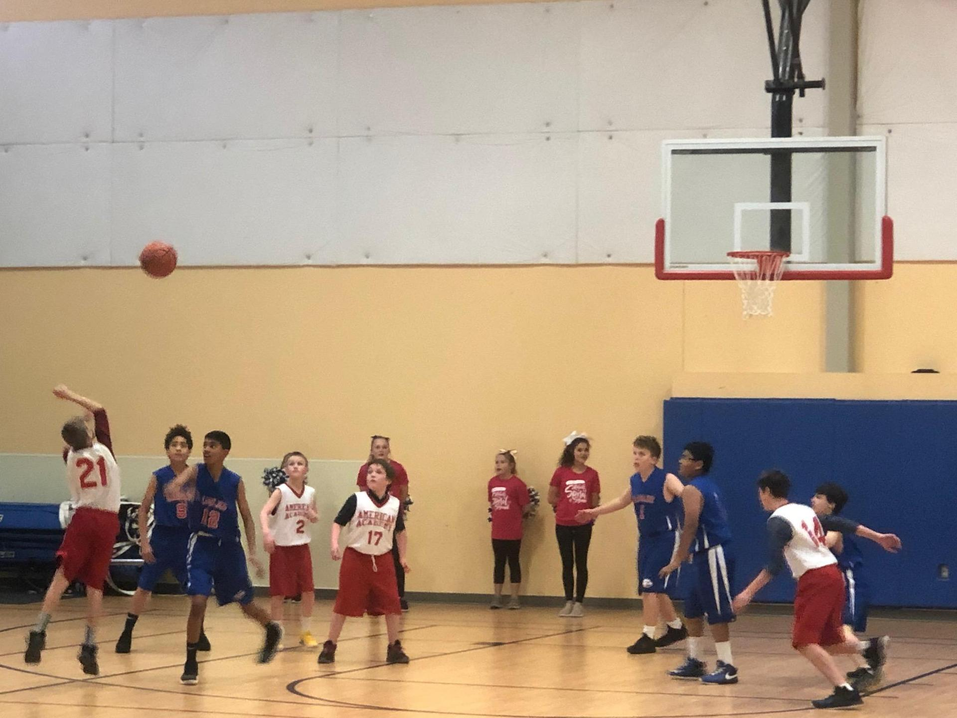Boys Basketball three point shot