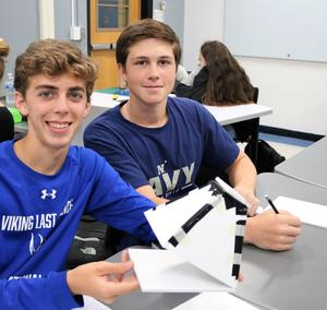 Westfield High School senior James Peretz (left) and junior Thomas Davis design and build a pinhole camera in Engineering and Design, a new course offering based on hands-on, project-based learning.