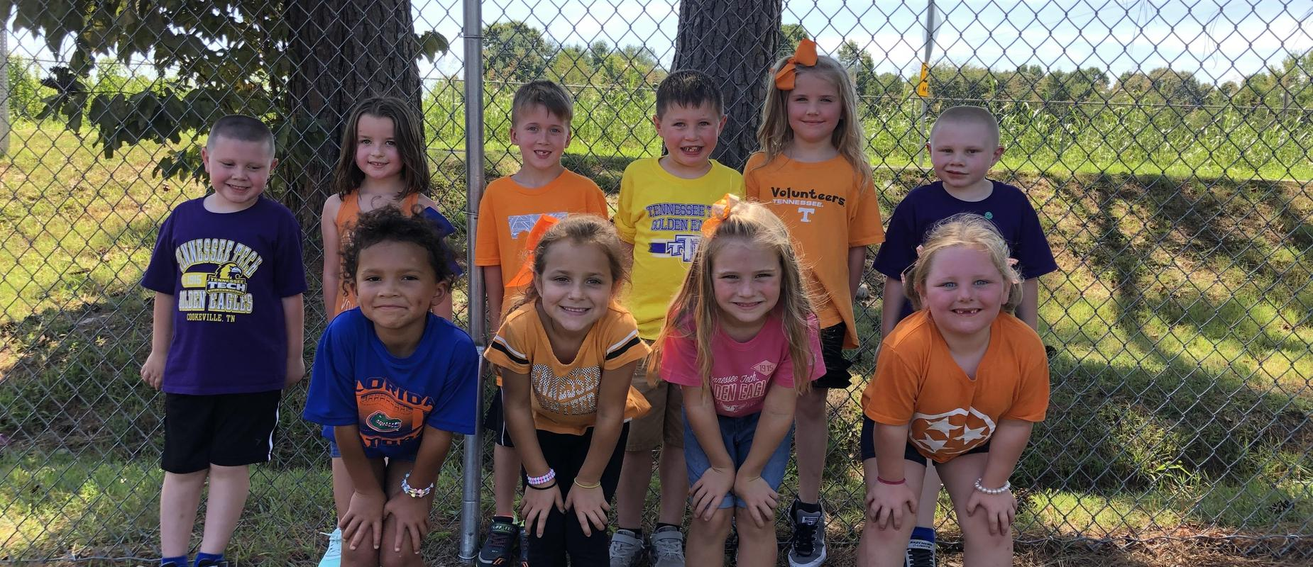 K - 1st grade students wearing college colors