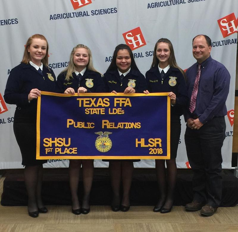 Public Relations Team and sponsor with State Banner