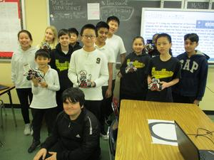 Group of kids holding Lego project