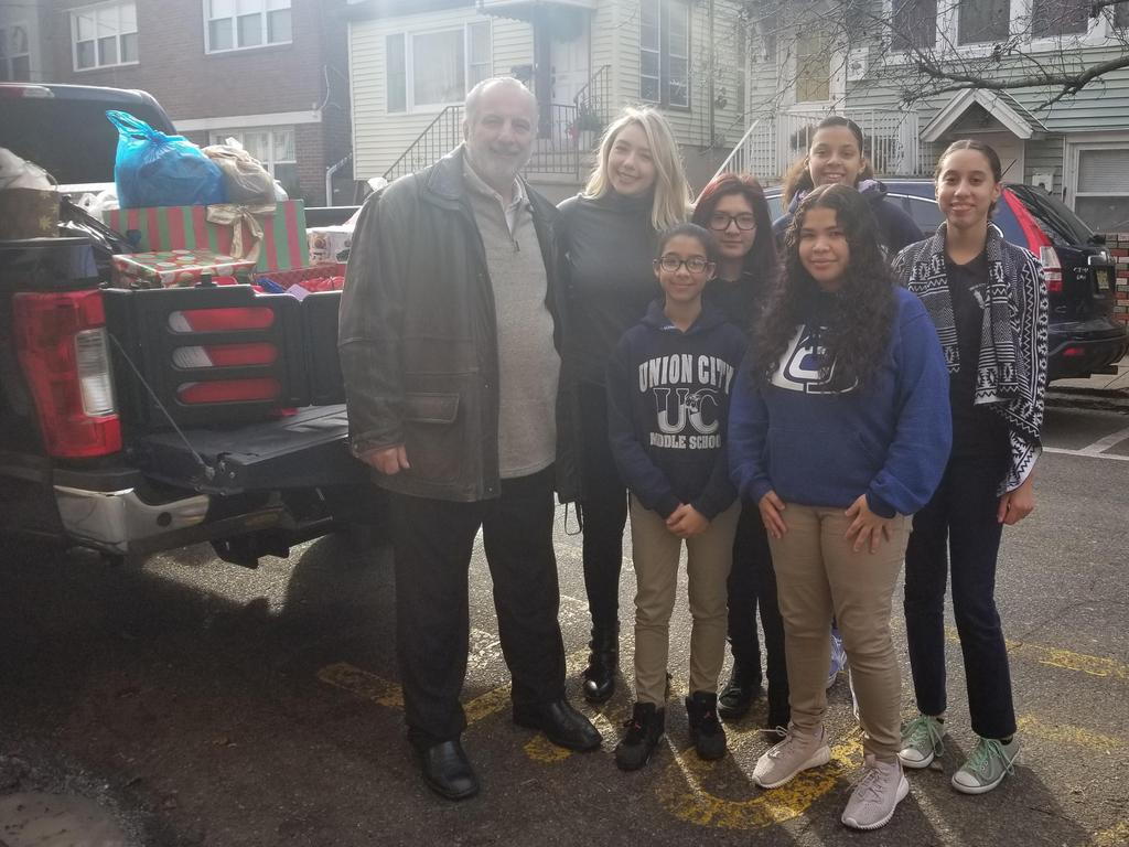 UHMS student council with supervisor introna and ms. velazquez taking the collected clothes to the PERCC shelter