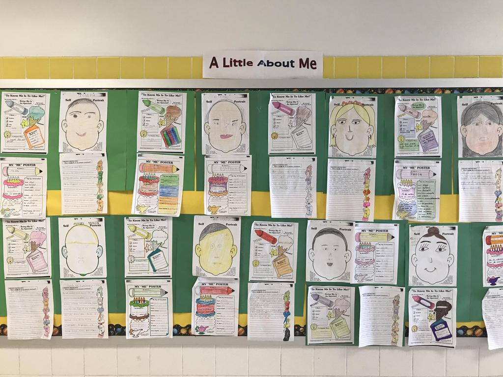 bulletin board display: self portrait with A Little About Me