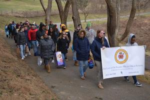 Participants in the OLSH Love Walk for the Poor walked throughout campus carrying donations