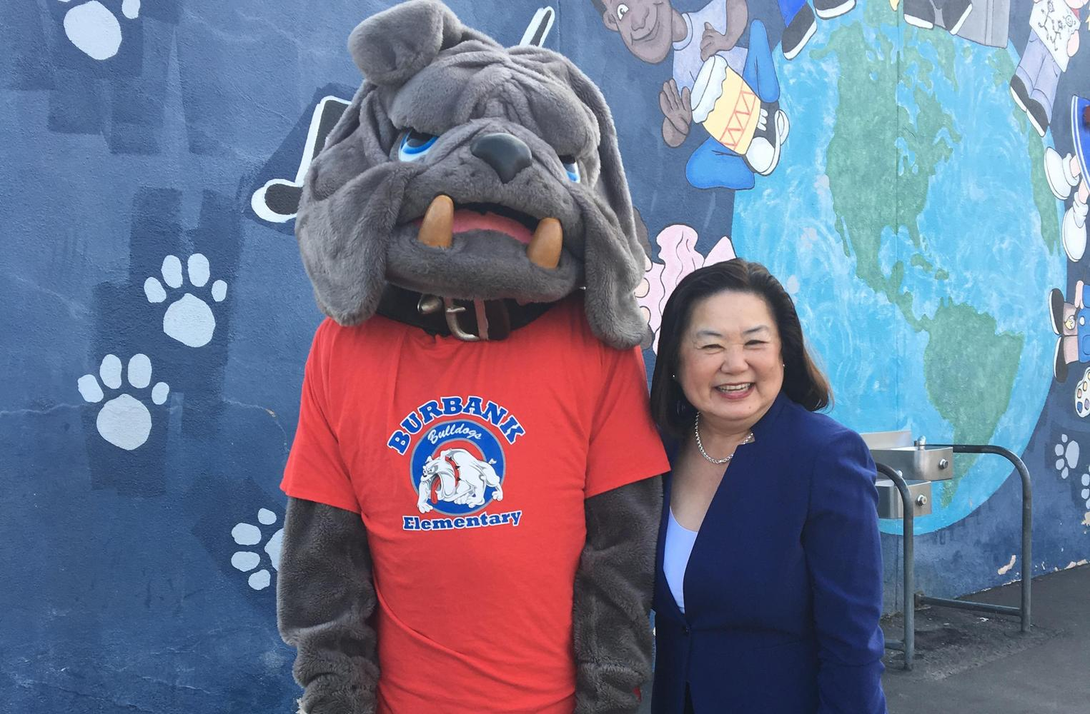 Superintendent and school mascot