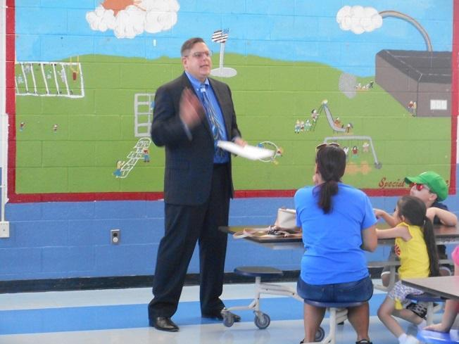 Mr. Gruber speaking to K parents and students