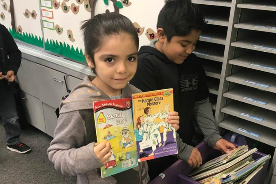 Esther L. Walter 2nd Graders take time to organize their classroom library