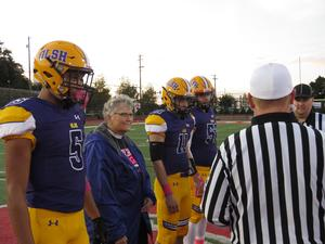photo of Sr. Francine Horos at the ceremonial coin toss